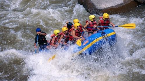 Water rafting against strong rapids in Denver