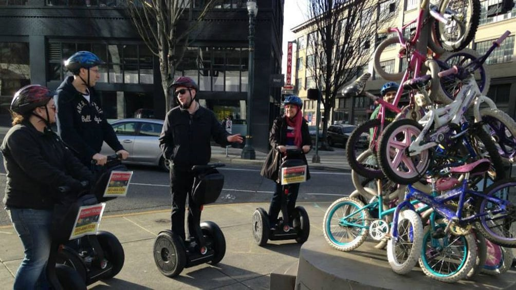 Guide tell group on segways about pile of bicycles and zoobooming in Portland