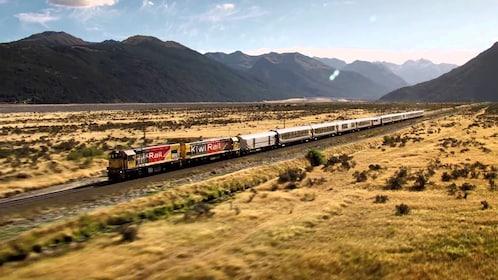 Train in valley in West Coast Franz Josef Glacier tour in Christchurch New Zealand.