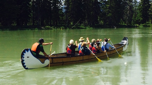 Take a voyage on a canoe through Banff National Park in the Bow River