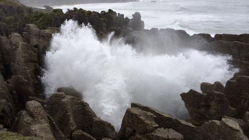 Waves crashing on rocks in West Coast Punakaiki in New Zealand.
