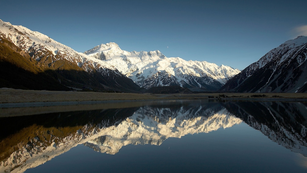 Show item 2 of 5. Reflection of Mount Cook  on water in New Zealand.