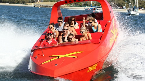 Group of people in the jet boat extreme ride and heli tour in the Gold Coast Australia.