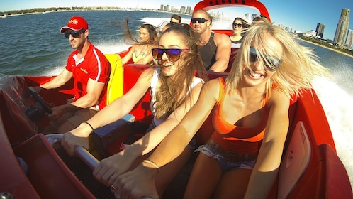 Close up of group of people in the jet boat extreme ride and heli tour in the Gold Coast Australia.