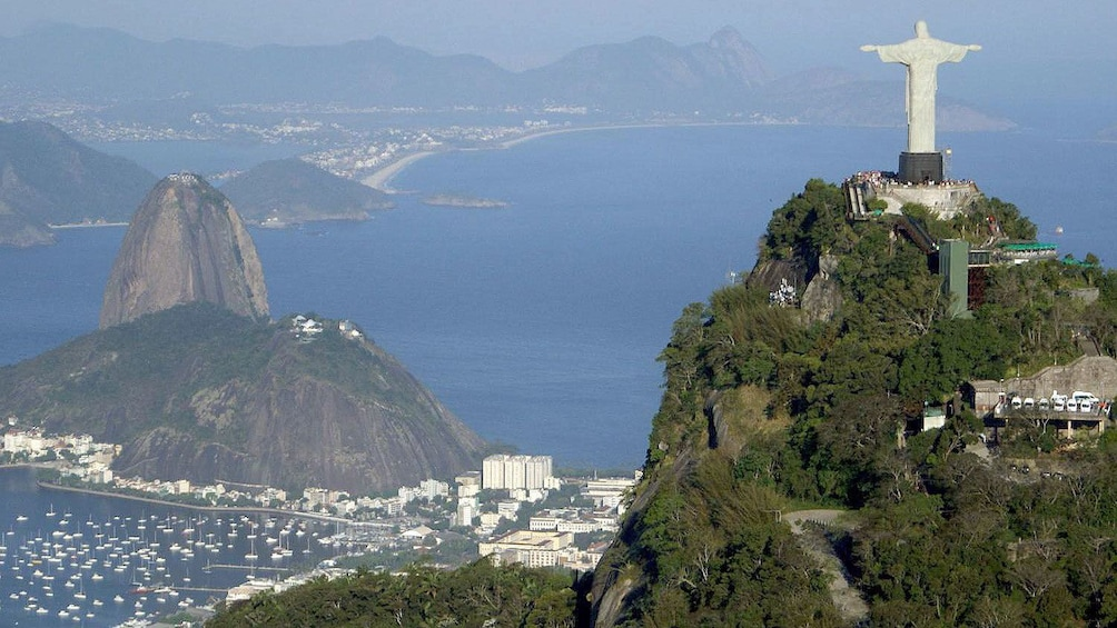 Christ the Redeemer looking down on Sugarloaf Mountain and Rio de Janeiro