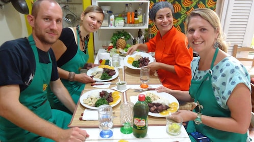Group enjoying meal prepared in a cooking class in Rio de Janeiro