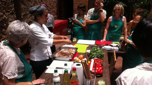 Cooking class receiving instructions from master chef in Rio de Janeiro