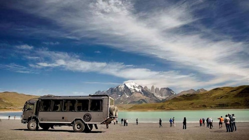 Tourists getting ready to board a Jeep for a tour of Torres del Paine National Park