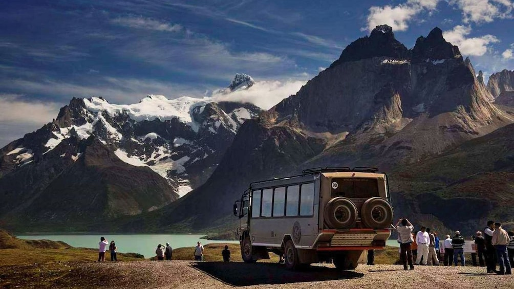 Show item 3 of 9. Beautiful view of Torres del Paine National Park with a Jeep at the foothill