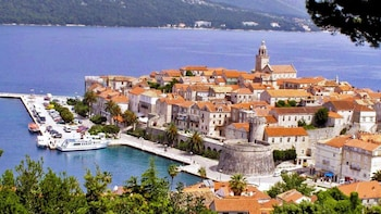 Show item 5 of 5. Boats docked at the bay of Korcula Island