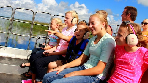 Close-up of airboat passengers in Orlando.
