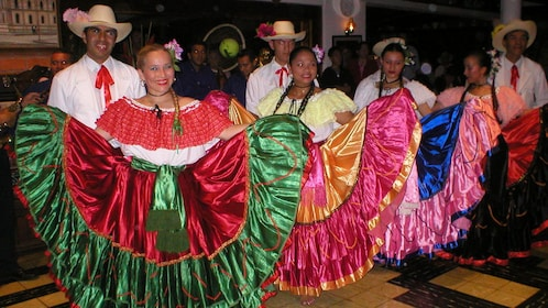 Dancers in colorful traditional costumes at the Ram Luna Dinner Show in San Jose