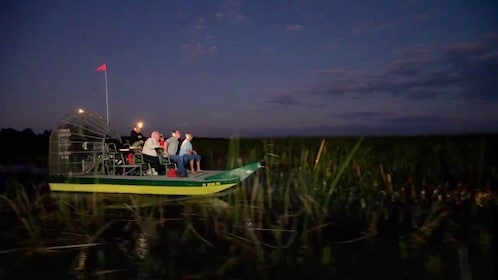 Airboat in the everglades at night with group in Orlando.