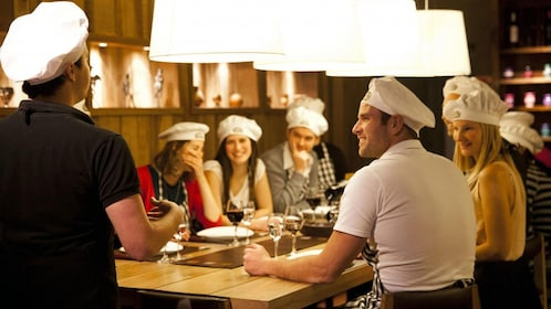 Group smiling during a cooking experience tour in Buenos Aires