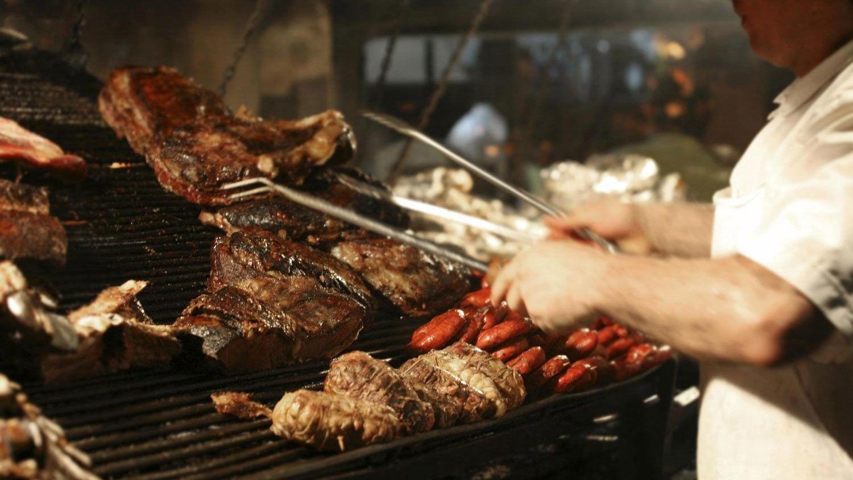 Man grilling food at the ranch at Estancia Santa Susana in Buenos Aires
