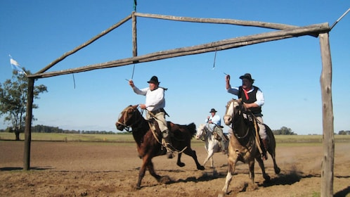 People riding on horses at the ranch at Estancia Santa Susana in Buenos Aires