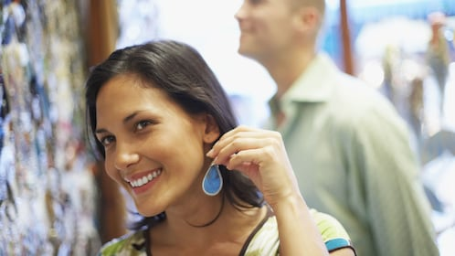 Woman shopping for earrings at the market in Iguazu