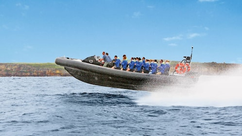 People on extreme offshore speed boat ride in the Gold Coast of Australia.