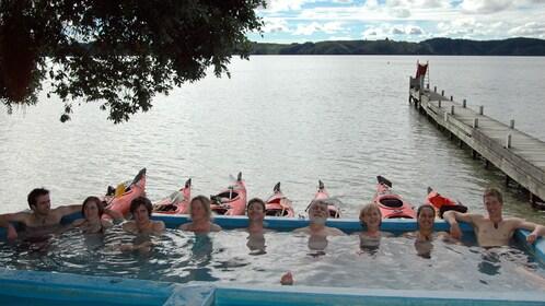 People in hot pool on Rotorua Guided Hotpools Kayak Trip in New Zealand.