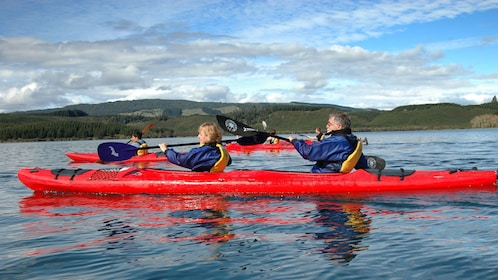 Group of kayakers on Rotorua Guided Hotpools Kayak Trip in New Zealand.