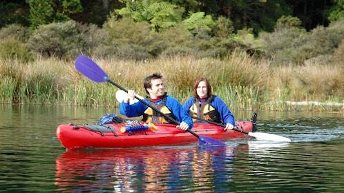 Kayakers on Rotorua Guided Hotpools Kayak Trip in New Zealand.