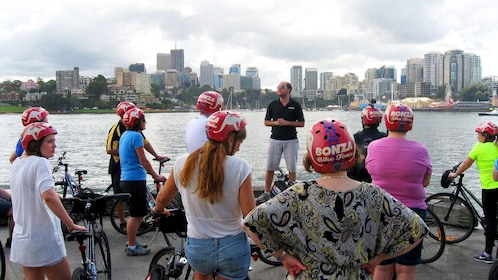 Tour guide talking to group on Sydney classic bike tour in Australia.