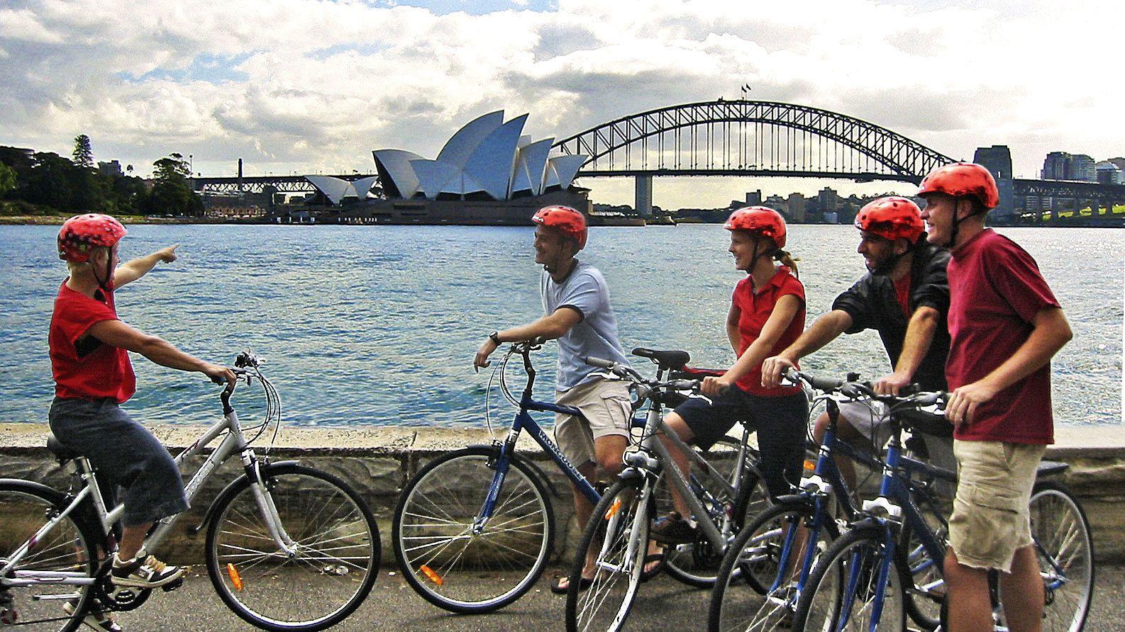People talking about Sydney Opera house on Sydney classic bike tour in Australia