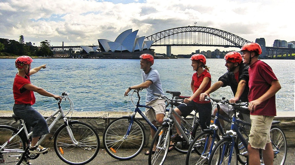 Show item 3 of 9. People talking about Sydney Opera house on Sydney classic bike tour in Australia