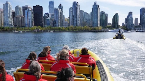 Raft moving towards the city in Vancouver