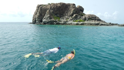 Couple snorkeling off the shores of Creole Rock in the Caribbean