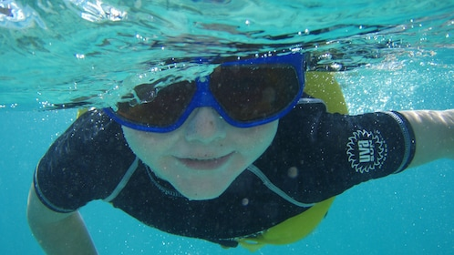 Child snorkeling in the Caribbean