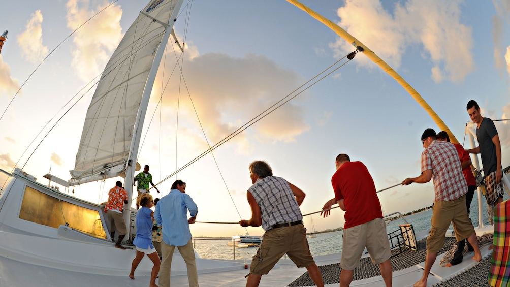 Show item 3 of 9. Crew of the Tango catamaran getting ready to set sail for Simpson Bay