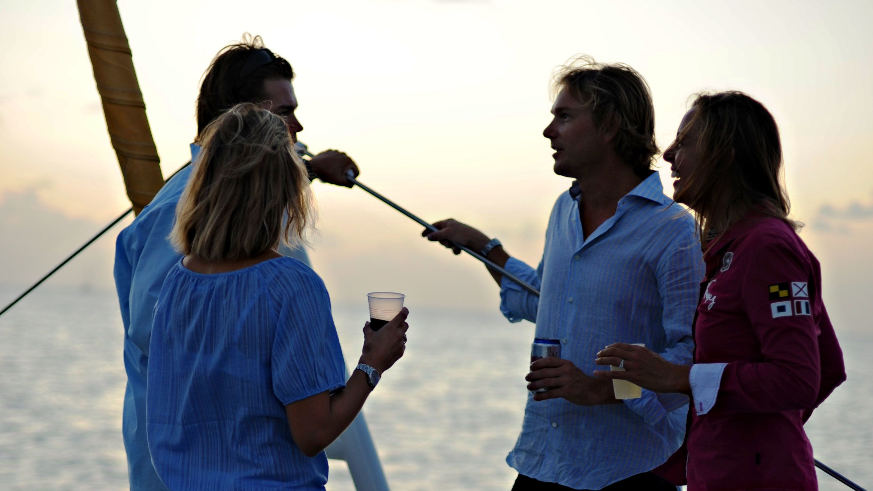 Couples enjoying drinks and views of the sunset from the Lambada catamaran