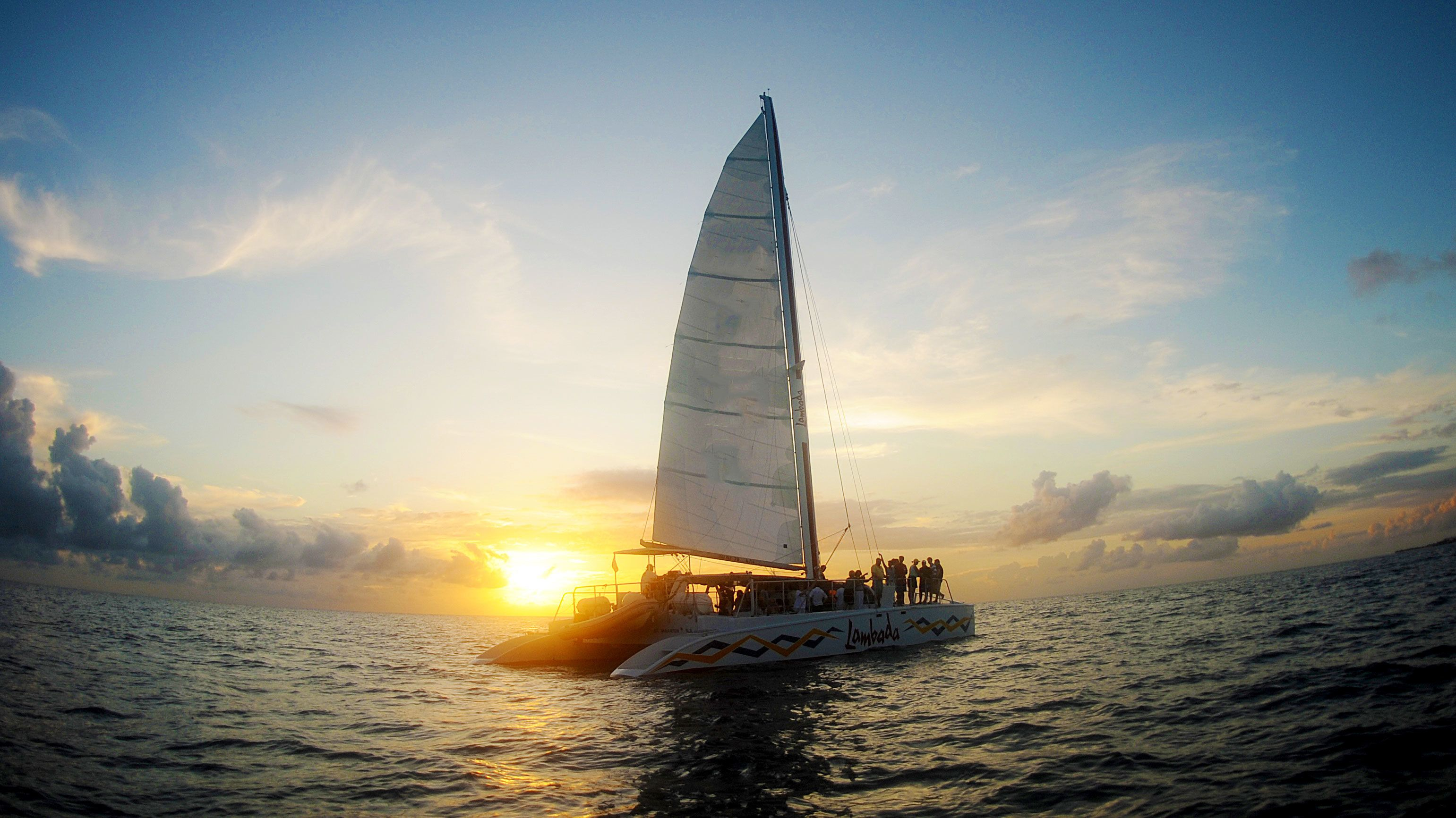 Lambada catamaran sailing off into the sunset