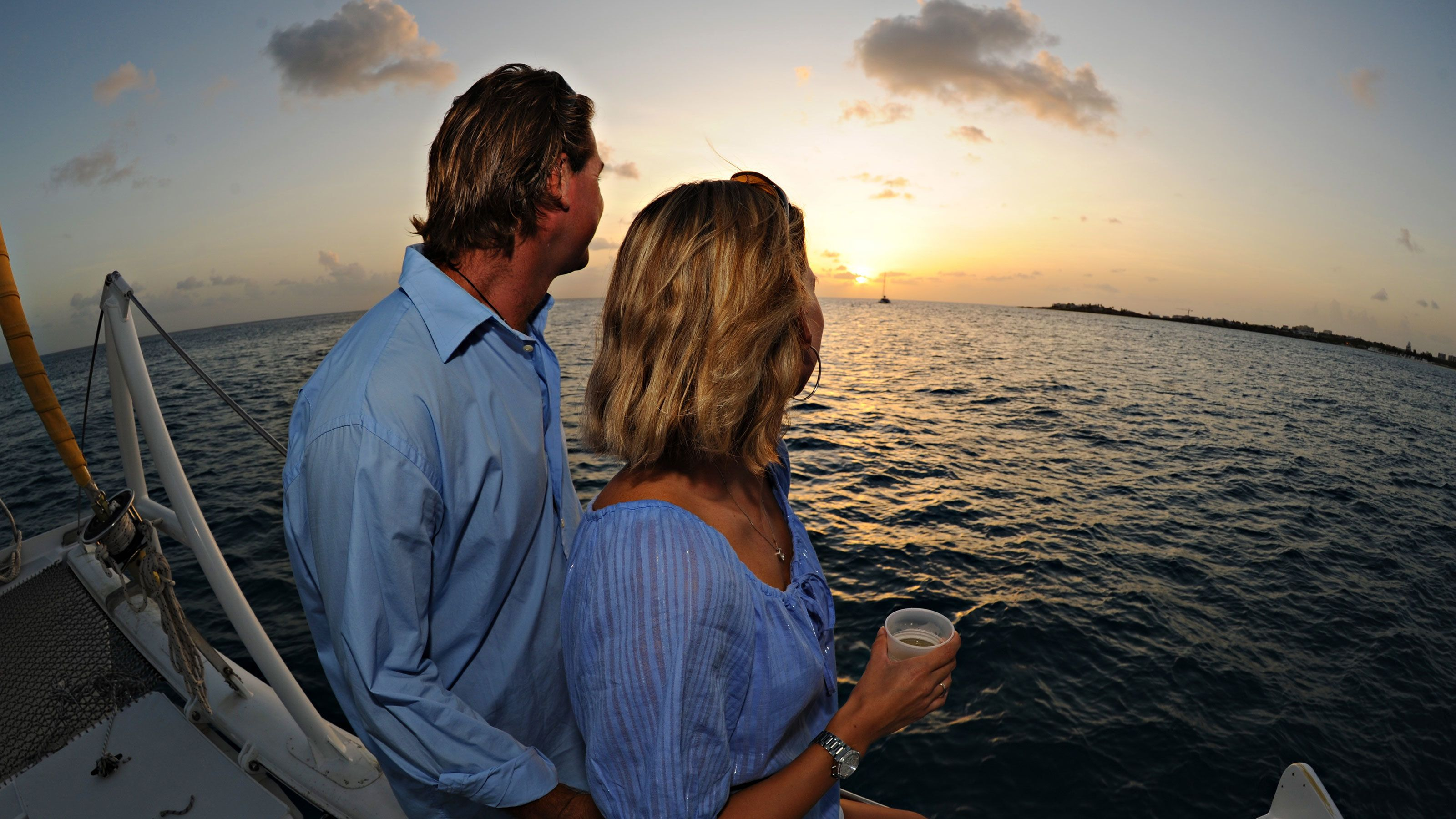 Couple enjoying the sunset onboard the Lambada catamaran