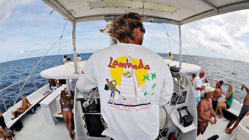 Captain of the Lambada catamaran navigating through the Anguilla Channel