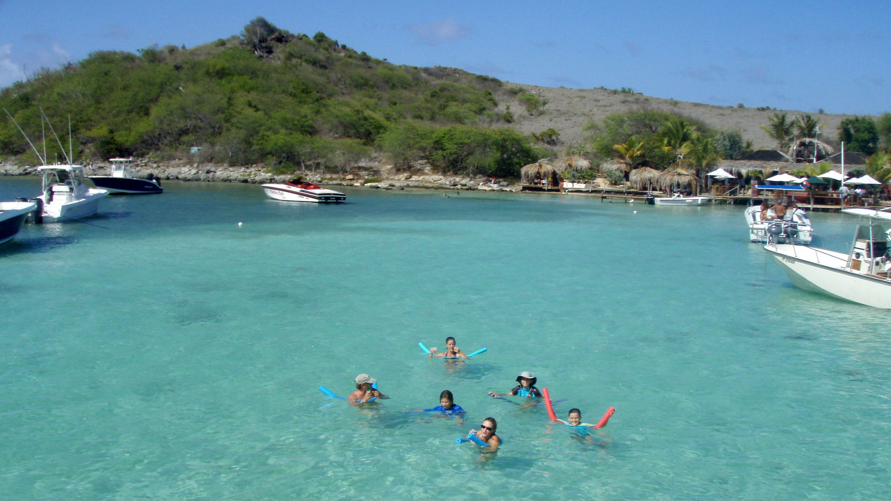 Group of tourists snorkeling off the coast of Tintamarre