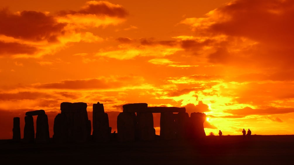 Show item 1 of 8. sunset behind Stonehenge in London