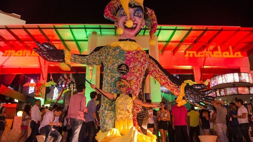 Street performer with a giant puppet outside a nightclub in Cancun