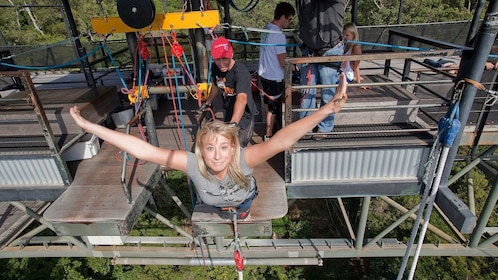 Girl starting her jump on the Cairns Combo Bungy Jump and Minjin Swing in Australia