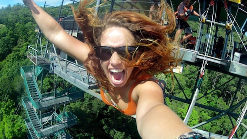 Girl on the Cairns Combo Bungy Jump and Minjin Swing in Australia