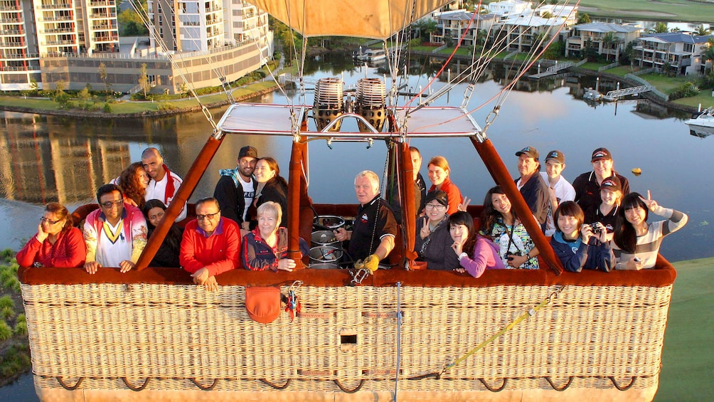 Show item 4 of 6. Group of people in the balloon basket on the Gold Coast Balloon Ride with Champagne Breakfast in Australia