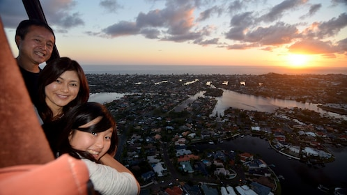 people enjoying panoramic view from inside hot air ballon in Gold Coast