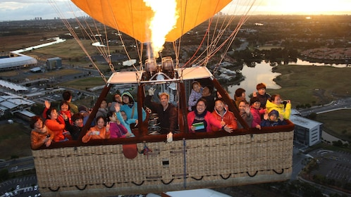 large group of people in hot air ballon basket in Gold Coast
