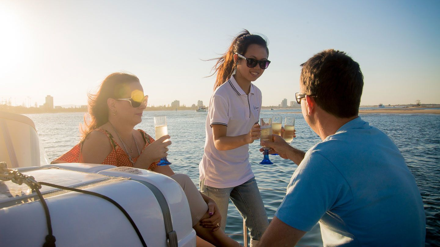 People drinking champagne on the Gold Coast Sailing Cruise with Champagne tour in Australia