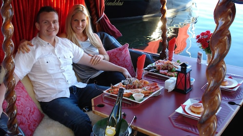 People eating on the Gold Coast Private Gondola Cruise in Australia