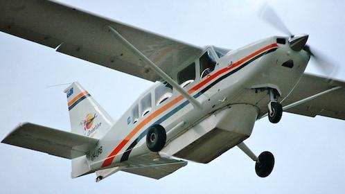 Up angle shot of the plane used on the Whitsunday Island Explorer Scenic Flight in Australia