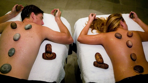 couple relax with hot stone massage at spa in Gold Coast