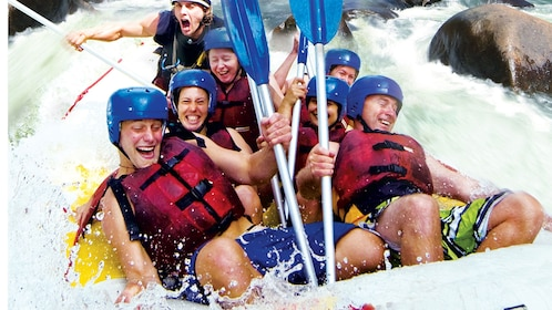 Group of people experiencing white rapids in Cairns