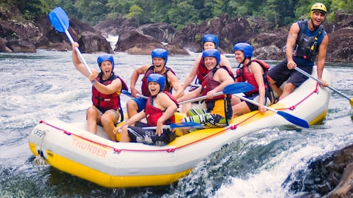 group of people in inflatable boat on rapids in Cairns